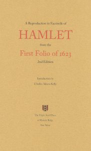 Image of the front cover of A Reproduction in Facsimile of Hamlet from the First Folio of 1623. It is a light brown cover with red and black lettering and includes the logo for the Triple Anvil Press, a red shield with three black anvils stacked vertically.